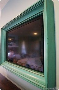 Framed tv.. such a good idea, because flat screens are SO ugly.