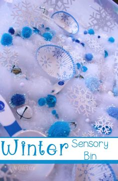 A beautiful snowflake sensory bin for winter. Great for toddlers and preschoolers to practice their fine-motor skills and social skills.