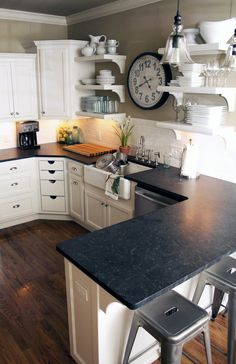 Like the contrast between the white cabinets & dark counter tops. Plus it has my PB pendants!