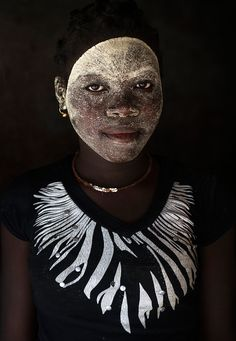 Africa | Woman With Muciro face mask.  Ibo Island, Mozambique | ©Eric Lafforgue
