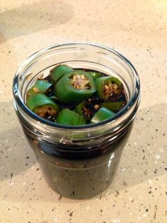 Pickled homegrown Serrano peppers, picked in soy sauce, sugar and vinegar with garlic and ginger. Good way to make peppers last and when it's ready to eat, the combo makes the soy sauce delicious for other dipping needs. #spicy