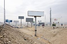 """'The Continuity of Man', a portrait of Cairo, Egypt taken by Nick Hannes in Sydney's annual """"Head On Photo Festival"""" [Image: Blank advertisement billboards along the highway in a satellite city of Cairo, Egypt,"""