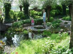 The trails surrounding this backyard water garden are fun for the whole family to explore. Photo by Maureen Gilmer. Learn more about different styles of backyard landscaping here: http://www.landscapingnetwork.com/backyard-ideas/landscape-types.html#