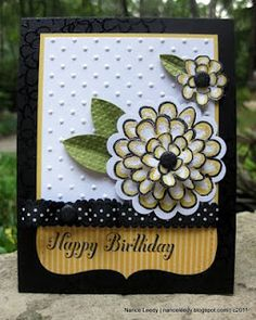 "stamps: bring on the cake, flower fest  ink: jet black stazon, versamark  paper: basic black, whisper white, daffodil delight, old olive CS; designer series pattern stack (brights)  xtras: glimmer brads (nuetrals); polka dot impressions folder; top note die; basic black polka dot scallop ribbon; 2 3/8"" scallop circle punch; build a blossom punch; black stampin' emboss powder"