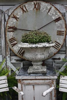 Love this huge clock and the old crusty urn. I Have this exact urn and my ex hid it from me in my move:( Huge Clock, Garden Clocks, Old Clocks, Vintage Clocks, Rustic Clocks, Antique Clocks, Antique Items, Garden Urns, Rusty Garden