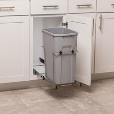 Simply Put Plastic Pull Out Trash Can at Lowe's. Tuck your trash away and keep the kitchen neat and clean with our Simply Put single soft-close waste bins. The bottom-mount waste bin organizer Hidden Trash Can Kitchen, Kitchen Trash Cans, Kitchen Cabinet Organization, Kitchen Storage, Cabinet Ideas, Kitchen Pantry Design, Kitchen Cabinets, Kitchen Layout, Kitchen Designs