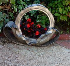 Porta piante da esterni ricavato da copertone auto.
