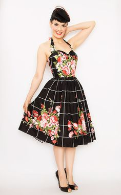 Bernie Dexter Pin Up Belle Halter Dress in Floral Bouquet is a classic style in a bold beautiful 100% print! Features boning for support, zipper in back & hidden lipstick pockets. Proudly made in the USA!