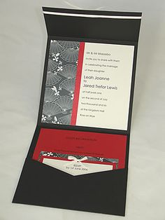 A Japanese style wedding invitations envelopments in black red and ivory with minimalist detailing.  Sophisticated for oriental style weddings
