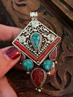 Tibetan jewelry - Tibetan Silver  - tribal - statement pendant -  inlaid with turquoise and coral mosaic shavings.
