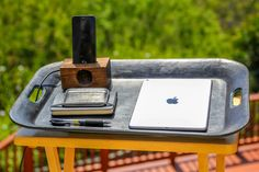 This black leather tray is the ideal lap companion for your outside workspace!   The leather tray's flat surface prevents your laptop from overheating and allows it a comfortable plane to rest on while charging. Its rounded edges and soft & sturdy material hold your computer in place whether you're typing or on the go to your next work station.    More the hosting type? Use it to serve your guests appetizers and drinks during your summer barbecues!   The tray is handcrafted out of organic…