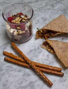 Easy lunch box ideas: spicy ground bison with butternut squash and quinoa with hummus on whole-wheat tortillas; a yogurt parfait; and pretzels. http://www.LunchBoxBlues.com