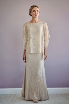 A glamorous lace flared mock two-piece gown tih a boat neckline, dolman sleeves and beaded trim. Mother Of The Bride Fashion, Mother Of The Bride Gowns, Blush Dresses, Bride Dresses, Bridesmaid Dresses, Gown With Jacket, Two Piece Gown, Mothers Dresses, Grooms Mother Dresses