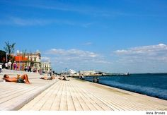 Afternoon sunbathing along the waterfront in Lisbon, Portugal  48 Hours In Lisbon: In Search Of Coffee, Tiles And Sun - Gadling by Anna Brones