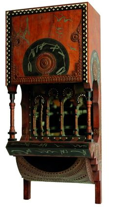 Carlo Bugatti (1856-1940),  Wall Cabinet, circa 1900,  stained wood and partially ebonized wood, pearl inlay, mirror, applied copper repoussé to bottom,  81 x 35.5 x 20 cm