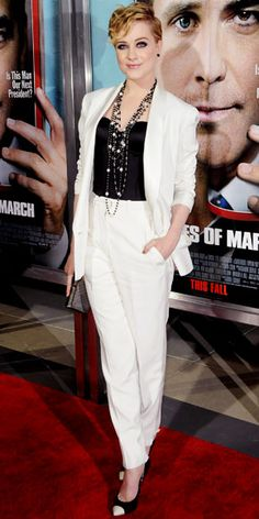Evan Rachel Wood in YSL suit, Salvatore Ferragamo clutch and cap-toe pumps - At the premiere of The Ides Of March.