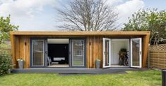 For the perfect office setting, what is better than one of our garden rooms? The team created this stunning garden office to the clients' exact preferences. Walk In Closet Design, Bike Shed, Garden Office, Minimalist Home, Storage Spaces, Outdoor Structures, Gallery, Building, Outdoor Decor
