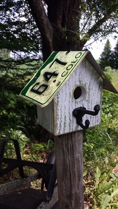 Colorado license plate roof on reclaimed wood birdhouse with acorn coat hook perch by RusticCabinManCave on Etsy