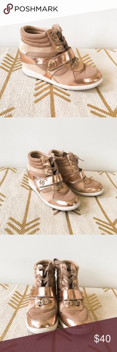 Michael Kors rose gold wedge sneakers Awesome Michael kors rose gold wedge sneakers! Lace up with Velcro strap. Gently used. Small stain on toe of left shoe, see 7th pic. Slight fading at the back of the right shoe. These are a youth 5, which is a women's 7. MICHAEL Michael Kors Shoes Wedges