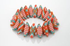 triangles by Suzanne Golden Neon Bracelets, Seed Bead Bracelets, Triangles, Geometric Jewelry, Metal Beads, Bead Art, Bead Weaving, Crystal Beads, Making Ideas