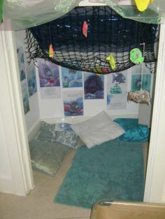 "The Baby room at Kidsunlimited Macintosh have used this alcove to make an ""under the sea"" themed hidey space for the children"