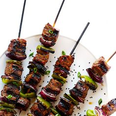 Asian Pepper Steak Kabobs Recipe Main Dishes with garlic, low sodium soy sauce, olive oil, rice vinegar, cracked black pepper, fresh ginger, low sodium soy sauce, rice vinegar, sesame oil, flank steak, bell pepper, purple onion, sliced green onions, toasted sesame seeds