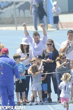Little Seraphina Affleck makes it to the finish line where sister, mom, Jennifer Garner and dad, Ben Affleck, cheer her on.