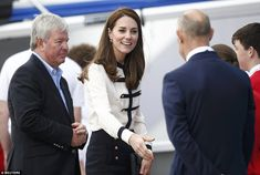 Kate had her brunette locks in a straighter style than normal with a side parting