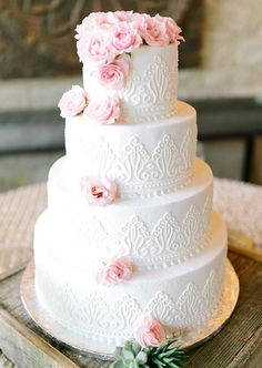 four tier cake with pink florals | Photo by Mint Photography