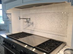 THIS IS IT! CHANGE NOTHING! Mother of pearl backsplash and subway tile combo....beautiful!
