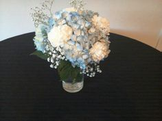 White carnation with blue hydrangeas and baby's breath