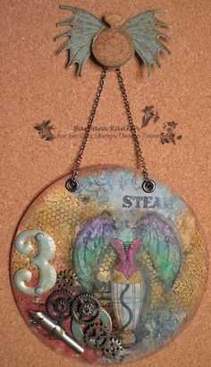Black Hole Art Studio: Altered CD Wall Hanging with Sin City Stamps
