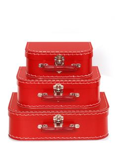 Beautiful red mini suitcases made of lightweight but sturdy cardboard. Even has metal latches. I have many and I forego the gift wrap and place my present inside these cuties. You can even add your home made luggage tags to the handles!