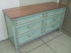 Vintage Aqua Dresser...the detail on this is just like a dresser i have except mine is probably another 2-3 feet longer with a cabinet door in the middle of the drawers...