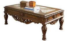 North Shore Coffee Table - The opulent brown finish flows beautifully over the decorative details to create a rich elegant atmosphere to any home environment. With beveled inlay marble inserts on the coffee table top, this furniture collection takes traditional style to the next level.