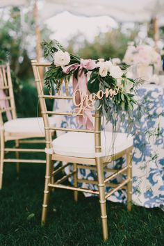 Floral accented groom's chair: http://www.stylemepretty.com/maine-weddings/cape-elizabeth-maine/2016/01/11/coastal-maine-summer-wedding-at-the-inn-by-the-sea/ | Photography: Emily Delamater - http://emilydelamater.com/