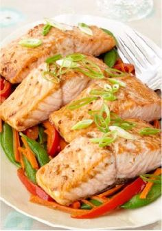 Sesame Salmon with Stir-Fried Vegetable Medley – An Asian-inspired take on salmon features sesame dressing for delicate flavor and fresh veggies in this low-cal, low-sodium dish.