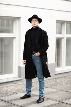 Classic men's outfit with black coat