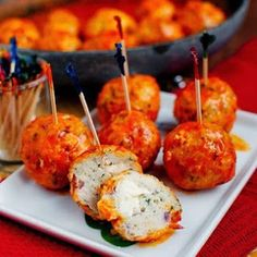 Buffalo Chicken Meatballs... could even stuff with blue cheese - Pre make these and cook on the fire - YUM