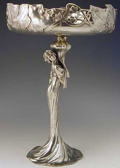 Polished pewter tazza with art nouveau full figural maiden. Ca. 1906