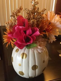 Fall baby shower, wedding, or party theme center pieces... Plastic pumpkin, gold paint, and flowers.
