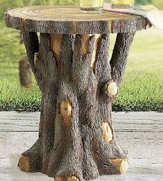 Tree Trunk Table - love the look of this one! we have two large trees just off our back deck that need to be taken down this year and I was thinking of having them cut off just the right height for a table . . . this looks like it could work beautifully.