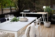 Outdoor patio   Ikea white tables, metal chairs + light wooden floor