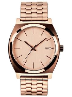 I love Nixon watches.  They are so classic and have a feminine look with a masculine edge.