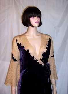 This is a lovely and luxurious,1920s vintage, eggplant colored silk velvet peignoir embellished with ecru lace around its neckline and its bell-shaped sleeves. The peignoir has two velvet sashes that have been tied into a bow for closure. It is in excellent vintage condition and is equivalent to a modern day Size Small.