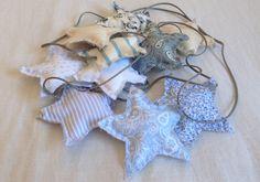 #Guirnalda de #estrellas en tonos azules hecha de diferentes retales de tela de…