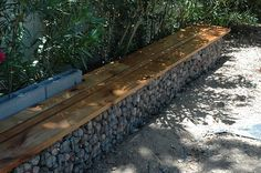 Looking for a new look for your fence? What about the gabion stone fence? I've always loved the look of gabion walls – the subtle variation in stone colour, the texture of different rock fillings and the light and shade of stone and crevice. Gabion Stone, Gabion Retaining Wall, Wall Bench, Wall Seating, Bench Seat, Back Gardens, Outdoor Gardens, Gabion Cages, Ideas Terraza