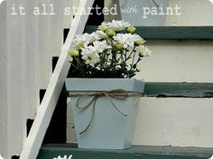 Love the spray painted planter with twine!