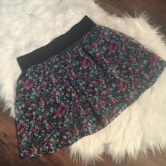 "Forever 21 Floral Skirt Forever 21 floral spring time skirt.  Black mini skirt layered under floral sheer.  Excellent condition. . 16"" length. Elastic waist band. Forever 21 Skirts"
