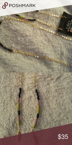 Function & Fringe Beautiful Dangle Earrings These are beautifully beaded in Navy, lime green and a pinkish Purple.  With Function & Fringe signature gold feather.  These are 5 inches long. Function & Fringe Jewelry Earrings